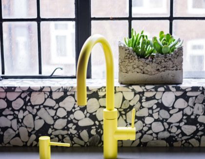 Caesarstone's industrial-inspired worktops specified for eclectic kitchen project in Sarah Akwisombe's Art Deco London apartment